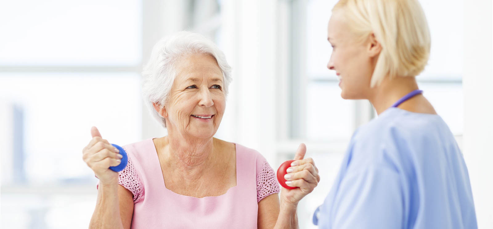 Nurse Assisting Senior Patient In Squeezing Stress Balls