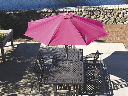 outside table with umbrella